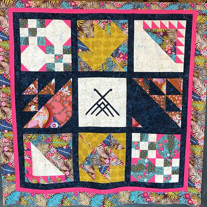 Teaser image for Quilting the North Woods: A Seasonal Block of the Month Quilt
